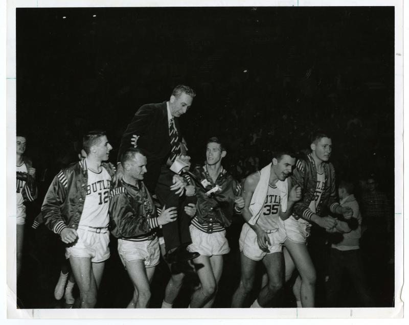 Photograph of Tony Hinkle being carried on the shoulders of the Butler University basketball team