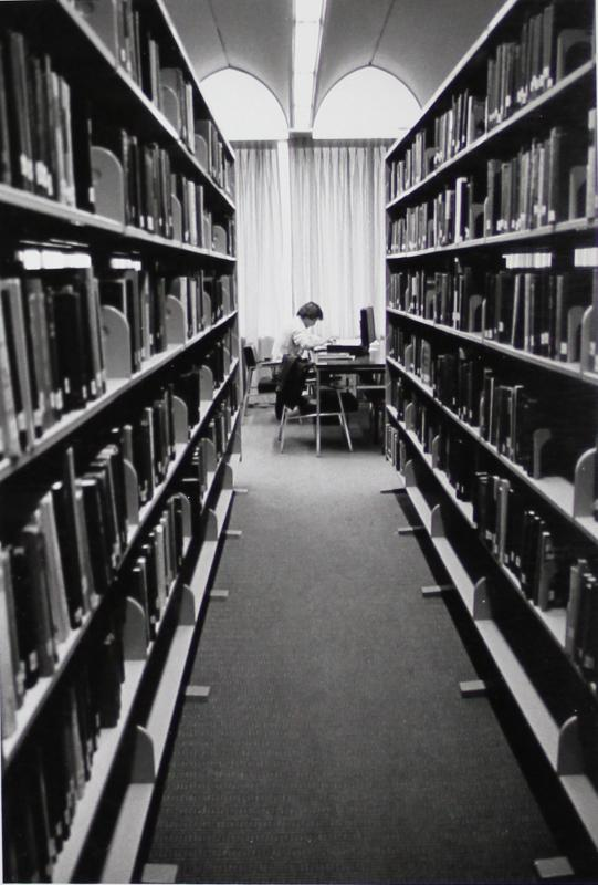 Student Reading in the Stacks in Butler University Irwin Library