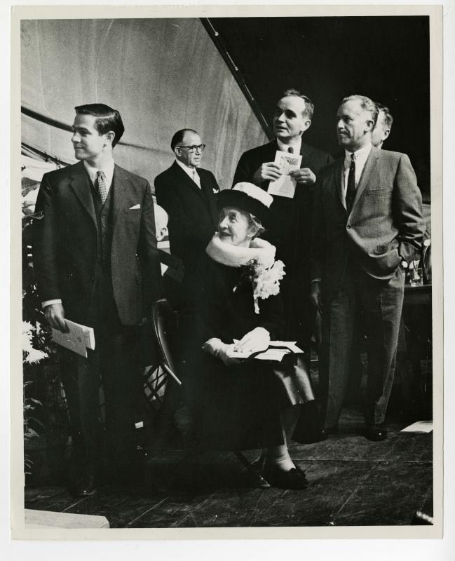 Photograph of Edith Whitehill Hinkel Clowes (seated) and Allen W. Clowes (holding program, standing behind Edith) with others at the cornerstone laying ceremony for Clowes Memorial Hall