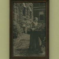 Framed photograph of Eliza A. Blaker in the yard of the Teachers College of Indianapolis