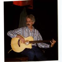 Photo of Faculty member playing a bass guitar.